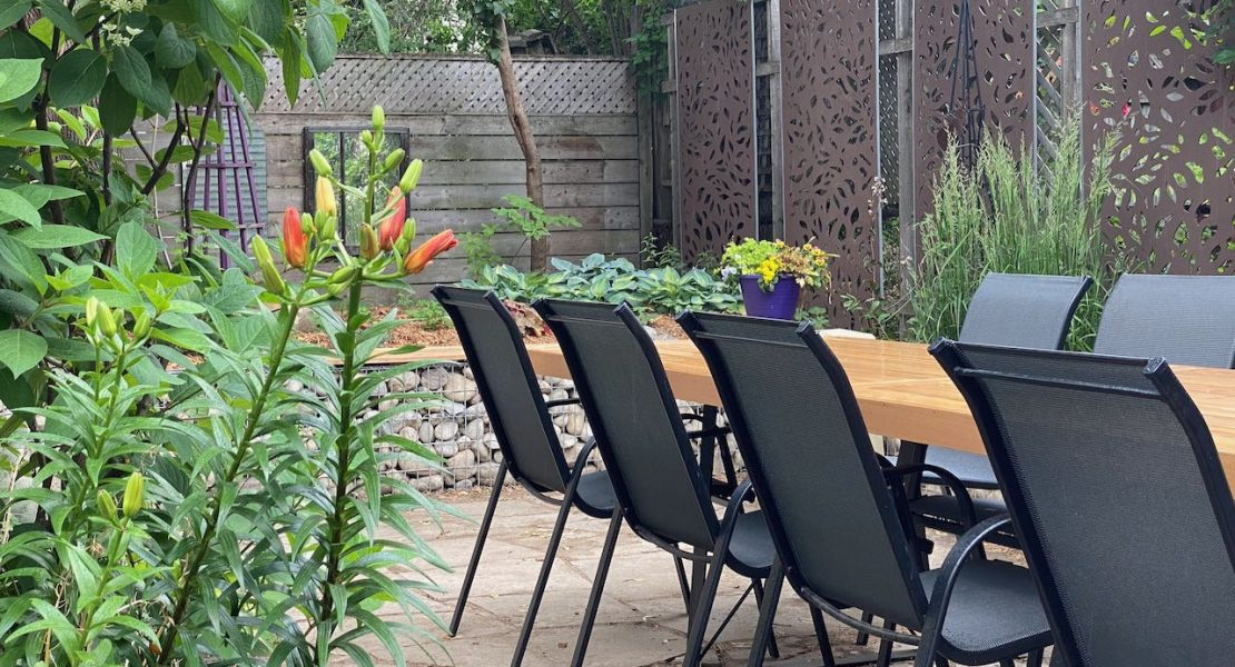 Outdoor dining area in a renovated garden